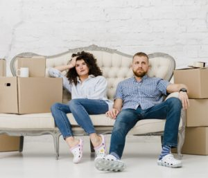 sad couple working on moving